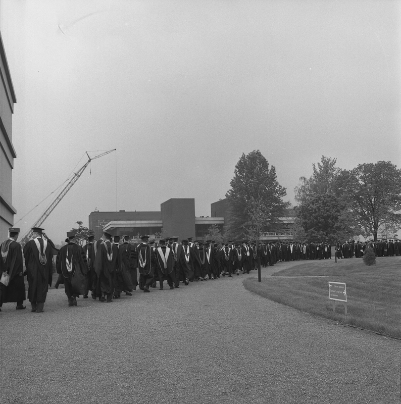 Photo of Faculty Entering Lovejoy Library for Campus Dedication